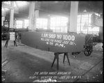 The fuselage of the 1000 De Havilland DH-4 produced by the Dayton-Wright Airplane Company set on sawhorses at Plant 1 at operation number one July 23, 1918 at 4:30 p.m.