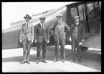 Dayton-Wright O.W.I. Aerial Coupe with four men standing for a group photograph at the Dayton-Wright Airplane Company by The Dayton-Wright Airplane Company