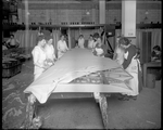 Female employees of the Dayton-Wright Airplane Company attach fabric to the skeleton of a De Havilland DH-4 wing at the Cloth Assembly Department