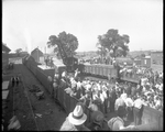 A crowd of people gather at a train yard to watch the packaged De Havilland DH-4s being loaded onto railroad cars for shipment from the Dayton-Wright Airplane Company