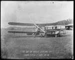 "Howard Rinehart stands between a De Havilland DH-4 and the Dayton-Wright ""The Messenger"" at the Dayton-Wright Airplane Company South Field August 14, 1918"