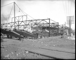 Construction at a Dayton-Wright Airplane Company factory builds around the fuselages of De Havilland DH-4s