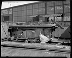 Damaged De Havilland DH-4 parts in a shipping crate at the Dayton-Wright Airplane Company