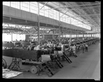 Employees of the Dayton-Wright Airplane Company work on the Dayton-Wright XB-1A fuselage and engines by The Dayton-Wright Airplane Company