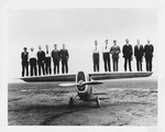 Employees of the Dayton-Wright Airplane Company stand on the wings of the Dayton-Wright RB-1