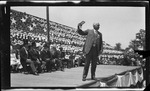Governor Judson Harmon displaying the State of Ohio medal to the crowd during the 1909 Wright Brothers Homecoming Celebration medals ceremony