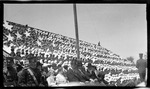 School children clothed in red, white, and blue, form the United States of America flag in the grandstands during the 1909 Wright Brothers Homecoming Celebration medals ceremony
