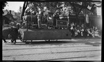 Horse-drawn parade float, featuring a railroad locomotive, at the 1909 Wright Brothers Homecoming Celebration