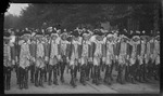 Patterson School boys dressed as colonial soldiers marching during the 1909 Wright Brothers Homecoming Celebration opening ceremonies