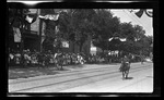 Colonel A. J. Clark, Governor of the Soldiers, Home riding on horseback with his staff in the parade during the 1909 Wright Brothers Homecoming Celebration by Andrew S. Iddings
