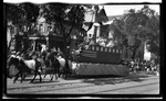 A parade float, featuring a canal boat, during the 1909 Wright Brothers Homecoming Celebration