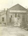 Rear view of Wright Cycle shop at 1127 West Third Street