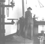 Wilbur Wright at work in the Wright Cycle shop