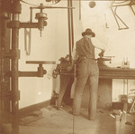 Wilbur Wright at work in Wright Cycle shop