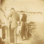 Orville Wright and Ed Sines at work in Wright Cycle shop