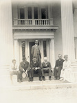 Group sitting on steps of Wright Hawthorn Hill home
