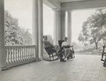 Orville and Katharine Wright sitting on porch