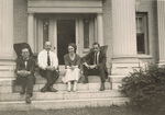 Group sitting on porch steps of Wright Hawthorn Hill home