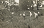 Orville Wright in a field with his nieces and nephews