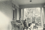 Group sitting on porch with Katharine Wright