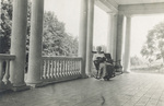 Katharine Wright reading on porch