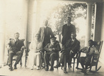 Group sitting and standing on porch of Wright Hawthorn Hill home