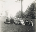 Group sitting on lawn of Wright Hawthorn Hill home