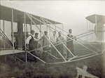 Aviators standing near the Flyer