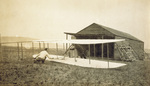 Wright 1911 Glider sitting outside camp building
