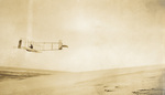 Orville Wright banking right in the Wright 1911 glider