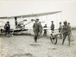 Wilbur Wright, Taylor, and soldiers with the Flyer