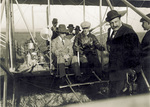 King Alfonso XIII and Wilbur Wright seated in the Wright Model A Flyer