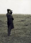 Orville Wright looking through binoculars