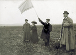 Orville Wright waving a signal flag