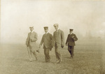 The Wright Brothers and the King walking across the flying field