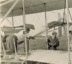 Orville Wright and others near the Flyer