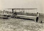 Orville Wright seated in Flyer