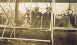Roosevelt and Hoxsey seated in Flyer