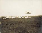 Wright Model B Flyer in flight near the hangars
