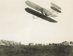 Orville Wright and the Wright Model A Flyer over the parade grounds at Fort Myer