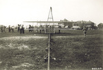 Orville and Wilbur Wright preparing to fly at Fort Myer