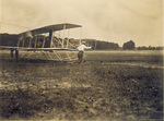 Wilbur Wright runs with the machine to start it