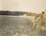 Orville Wright landing in a cloud of dust at Fort Myer