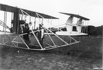 Orville and Wilbur Wright with the Signal Corps Flyer