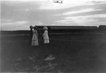 Women watch the Signal Corps Flyer