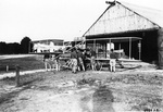 Charlie Taylor and soldiers in front of a hangar