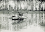 Two men testing Wright Model CH Flyer in Miami River.