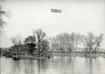 Wright Model CH Flyer in flight over Miami River