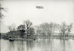 Wright Model CH Flyer in high flight over Miami River
