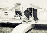 Orville Wright and A. F. Barnes inspect Wright Model G Aeroboat